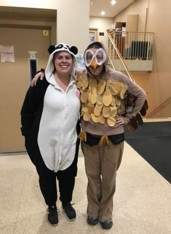 Janice dressed up in an owl costume next to a friend, who is dressed up in a panda costume
