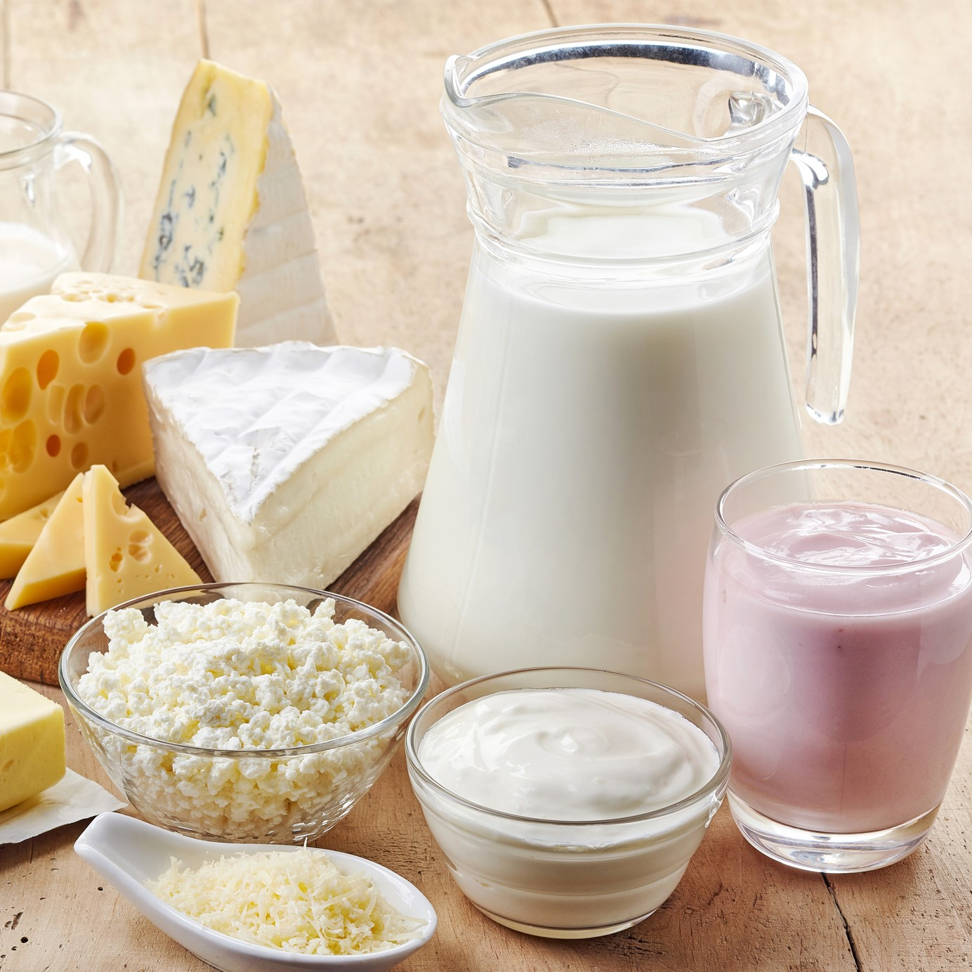 Various fresh dairy products on wooden background